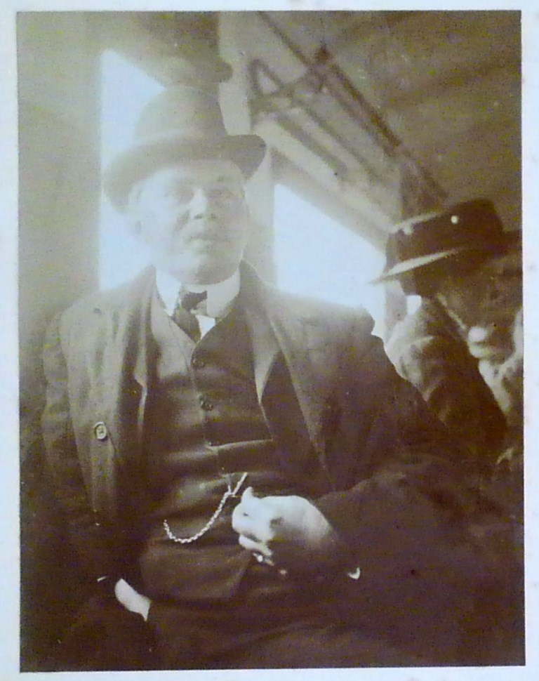 John Edward Marr seated on train